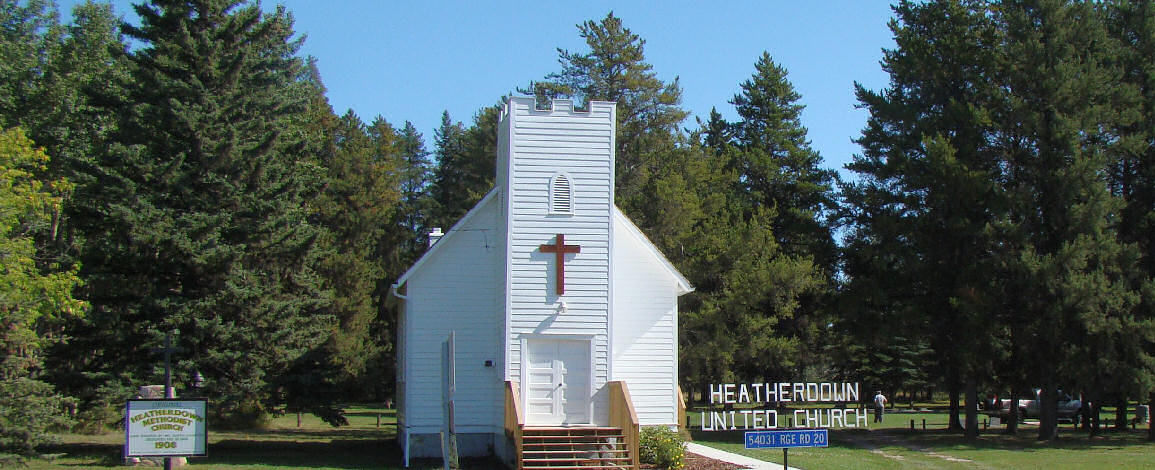 Image of the Heatherdown United Church with the Cemetery in the background